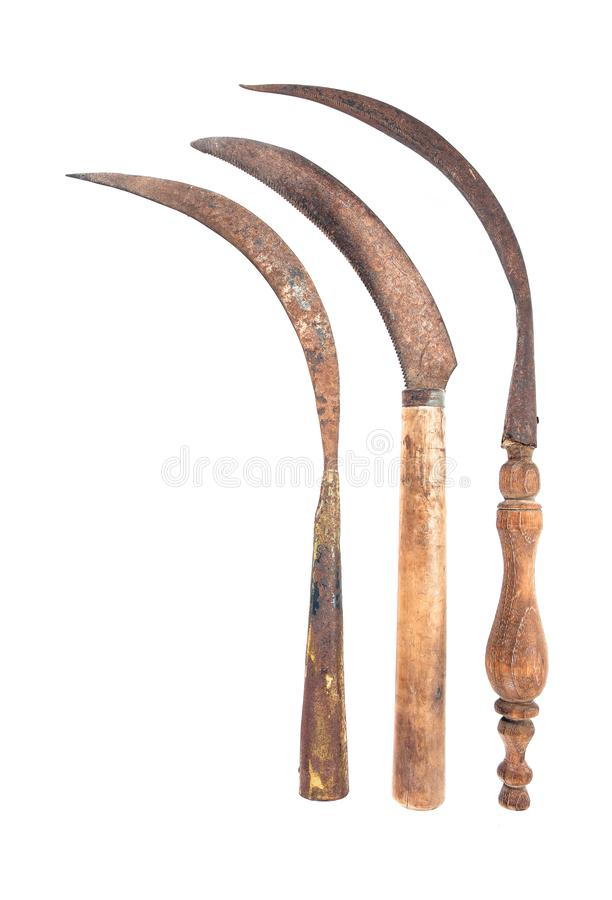 Three old rusty sickle isolated on white background. Old vintage sickle style. Thailand old sickle stock images