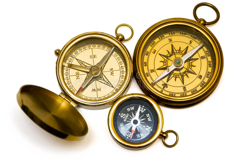Three old style brass compasses royalty free stock photo
