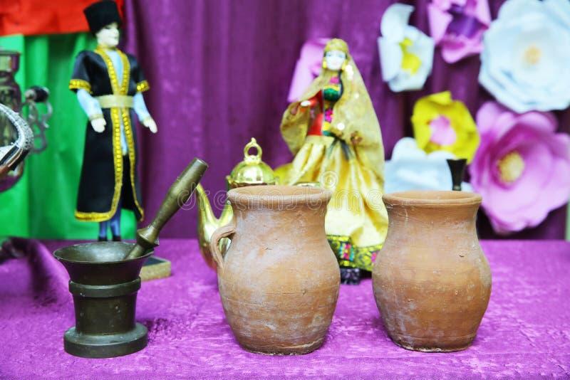 Antique bronze mortar isolated . Piti food bowl . The main ingredients of Azerbaijani Piti bowls . Three old tibetan stock photo