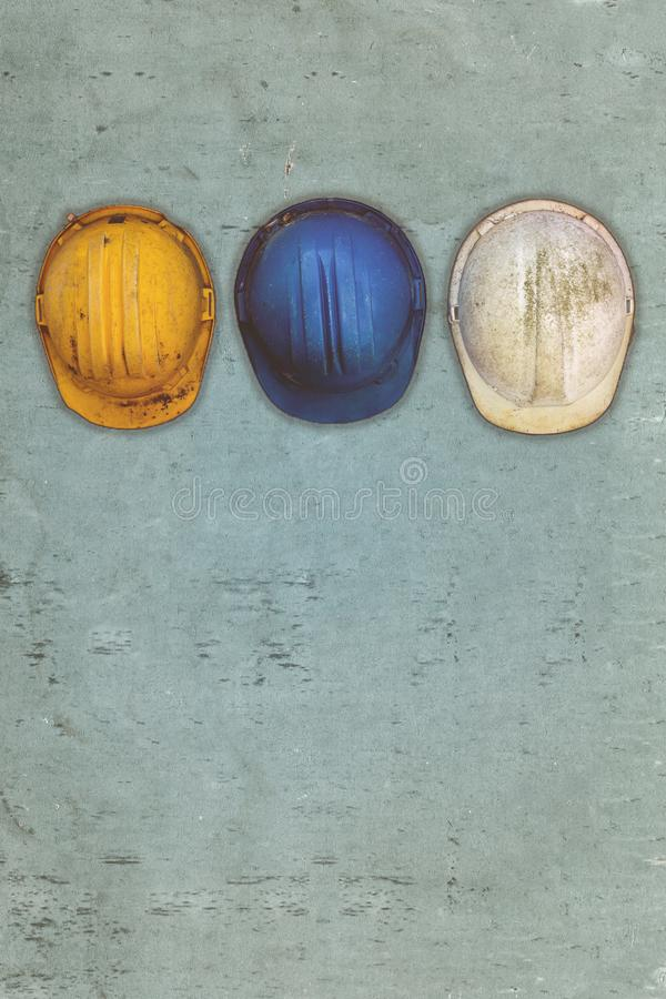 Three old and worn construction helmets royalty free stock photography