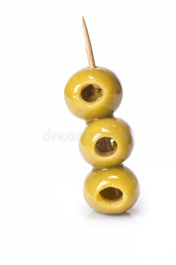 Three olives on a toothpick royalty free stock image