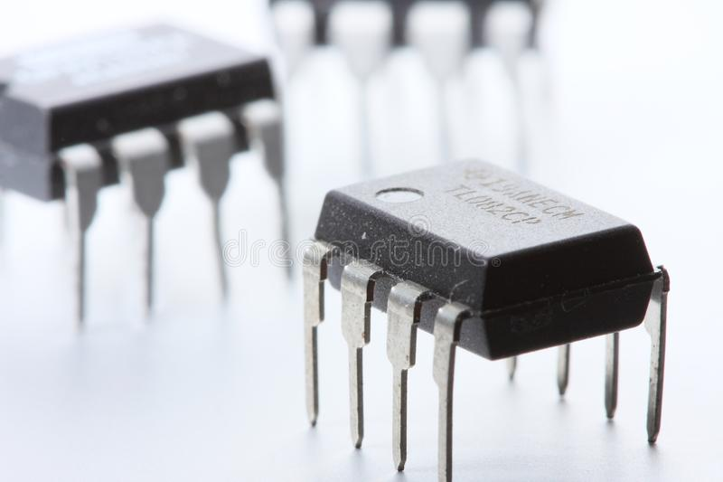 Download Three op-amps on white stock photo. Image of white, semiconductor - 10345672