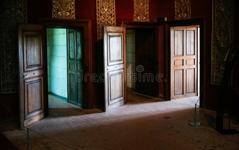 Three open doors in castle Chateau de Chambord royalty free stock images