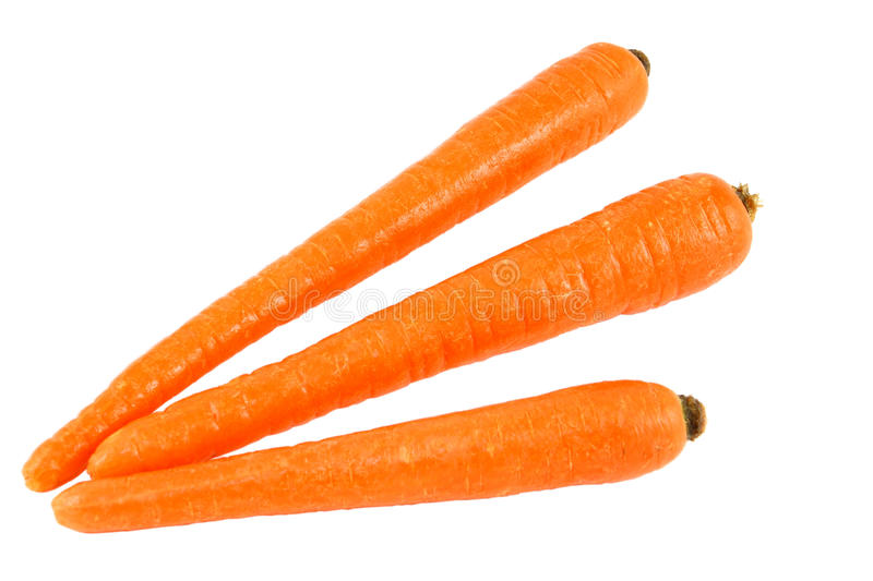 Three Orange Carrots Isolated On White royalty free stock photo