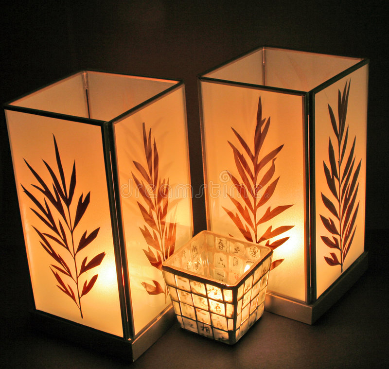 Three Oriental Candles. A group of three beautiful oriental candles royalty free stock photo