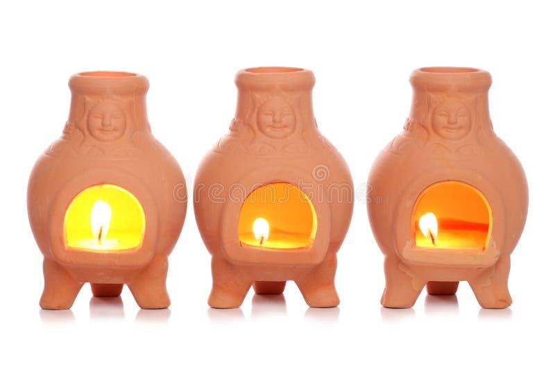 Three outdoor candles stock photos