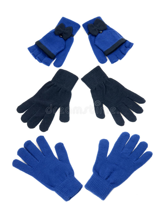 Three pair of dark blue gloves. Winter accessories isolated on white background royalty free stock images