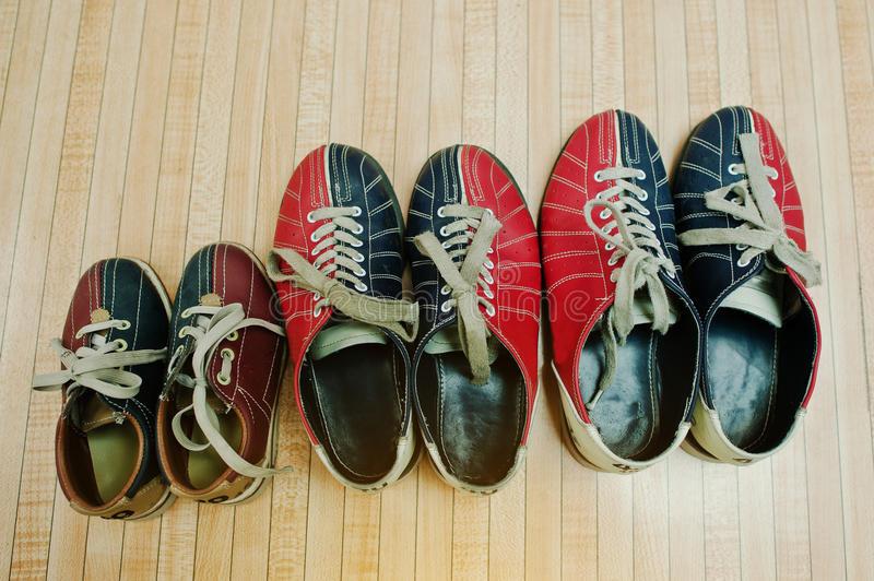 Three pairs of shoes for bowling stock photo