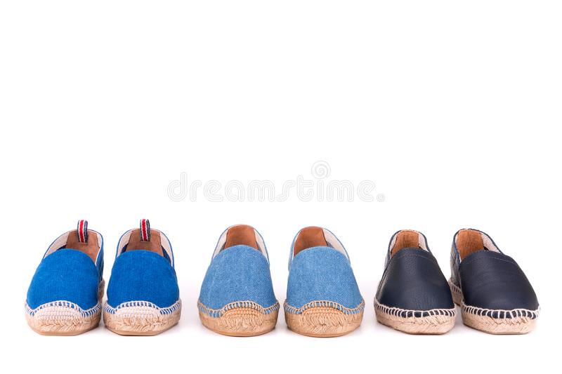 Summer espadrilles on a white background. Three pairs of summer espadrilles on white background royalty free stock image