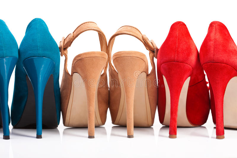 Three pairs of women's shoes with. Heels on a white background royalty free stock photography