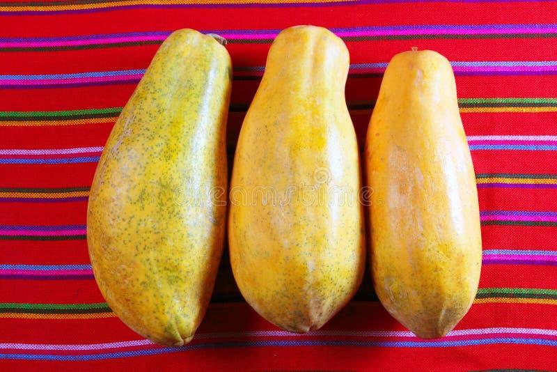 Three Papaya Fruits On Latin Serape Tablecloth Stock Photo