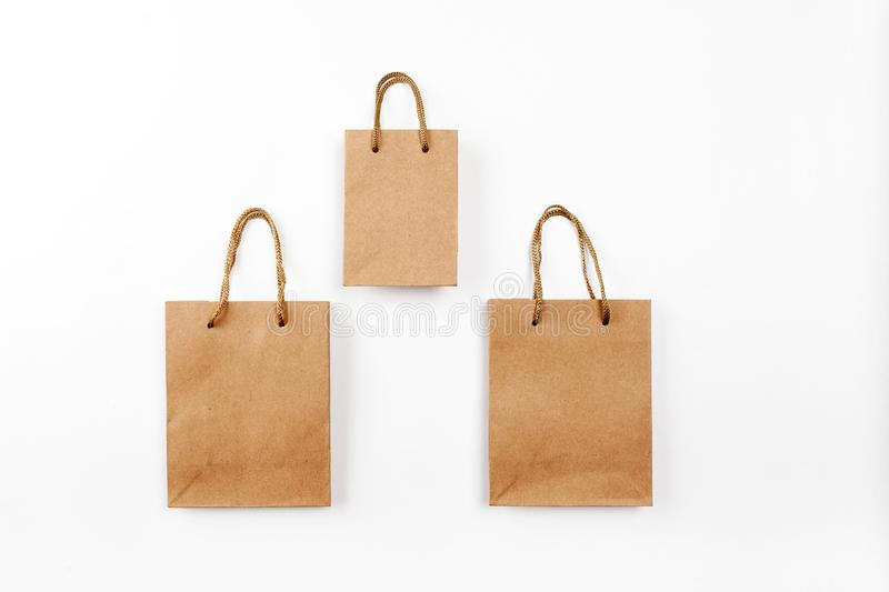 Three paper bags with handles on a white background, top view.  royalty free stock image