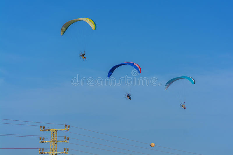 Three para motor gliders flying stock image
