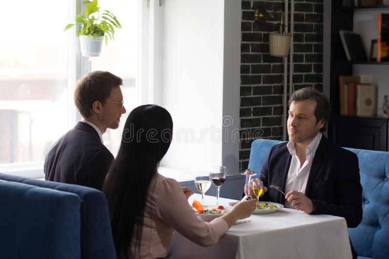 Business people having lunch at luxury restaurant royalty free stock photo