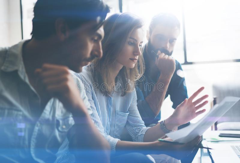 Three partners making research for new business direction. Business people meeting concept. Blurred background. Cropped. royalty free stock photography