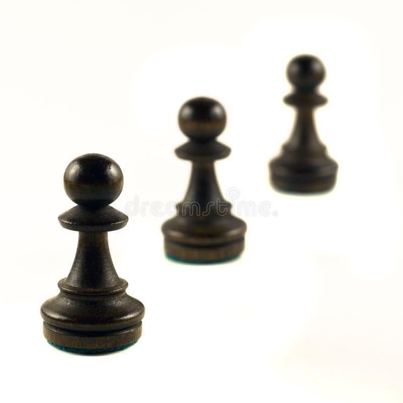 Three Pawns stock photos