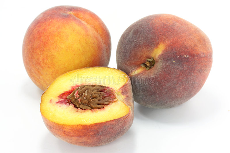 Three peaches. On a white background royalty free stock images
