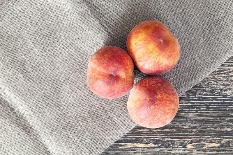 three peaches stock image