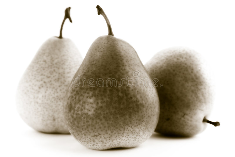 Three pears on a white background stock photos
