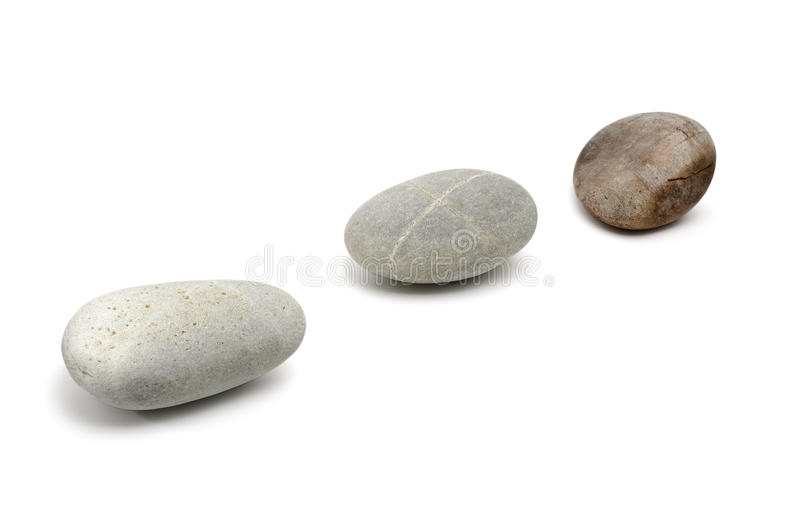 Three Pebble. Stones in a Row royalty free stock image