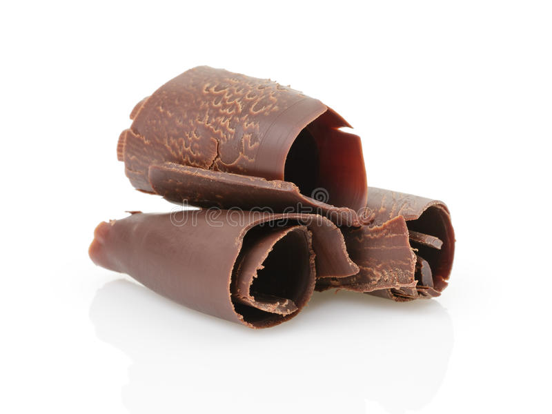 Three peeled chocolate curls royalty free stock image