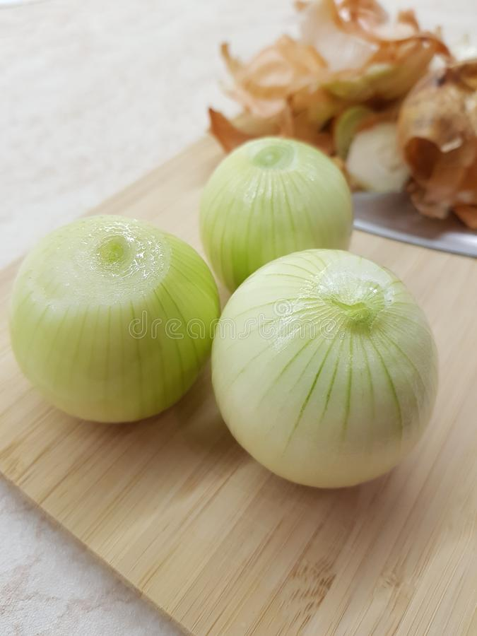 Three peeled onions royalty free stock images