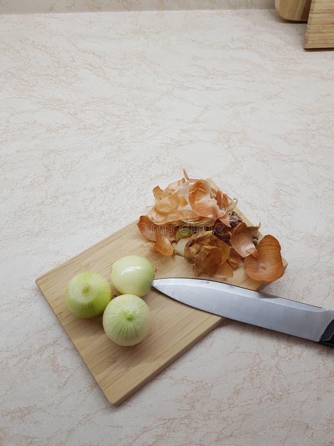 Three peeled onions royalty free stock photos