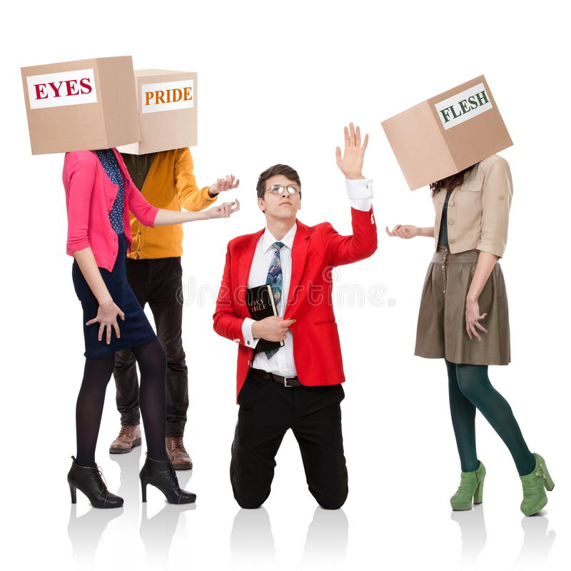 The call of temptations. Three people with boxes in the head that call a young men with a Bible. Concept of the call of temptations stock photos