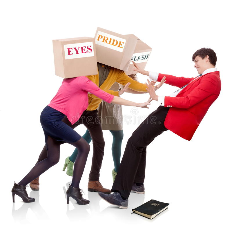 Pushing to fall down. Three people with boxes in the head that push a young men to fall down. Spiritual concept royalty free stock images