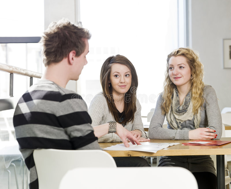 Three people communicate royalty free stock photography