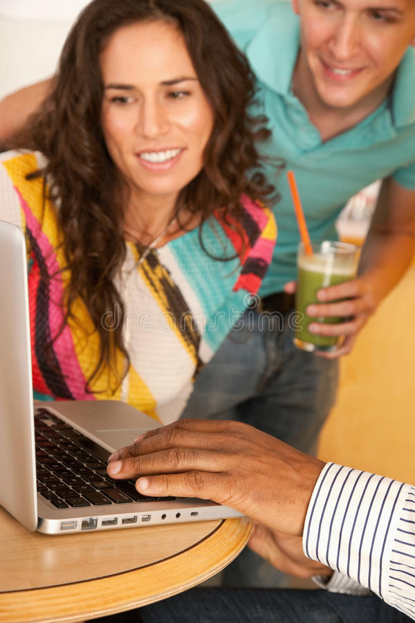 Download Three People Dining Out Using A Laptop Stock Image - Image: 14885879