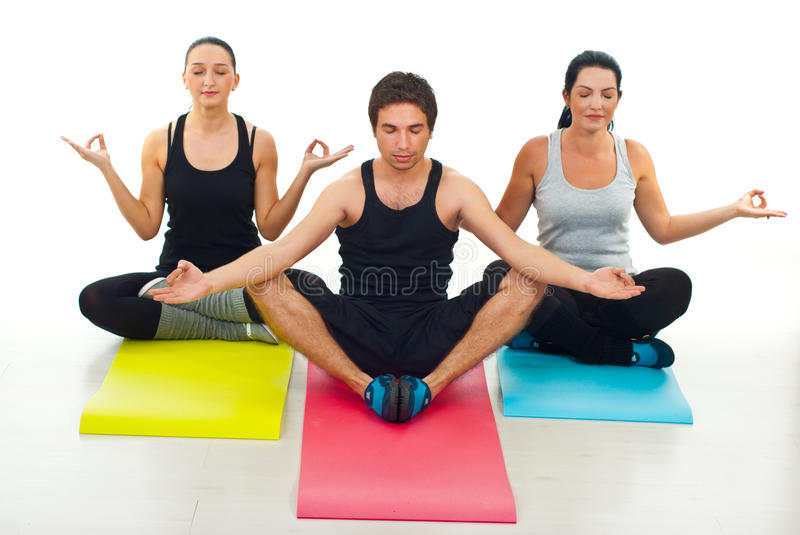 Download Three people doing yoga stock image. Image of club, people - 21170649