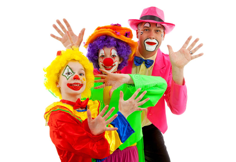 Three people dressed up as colorful funny clowns royalty free stock images