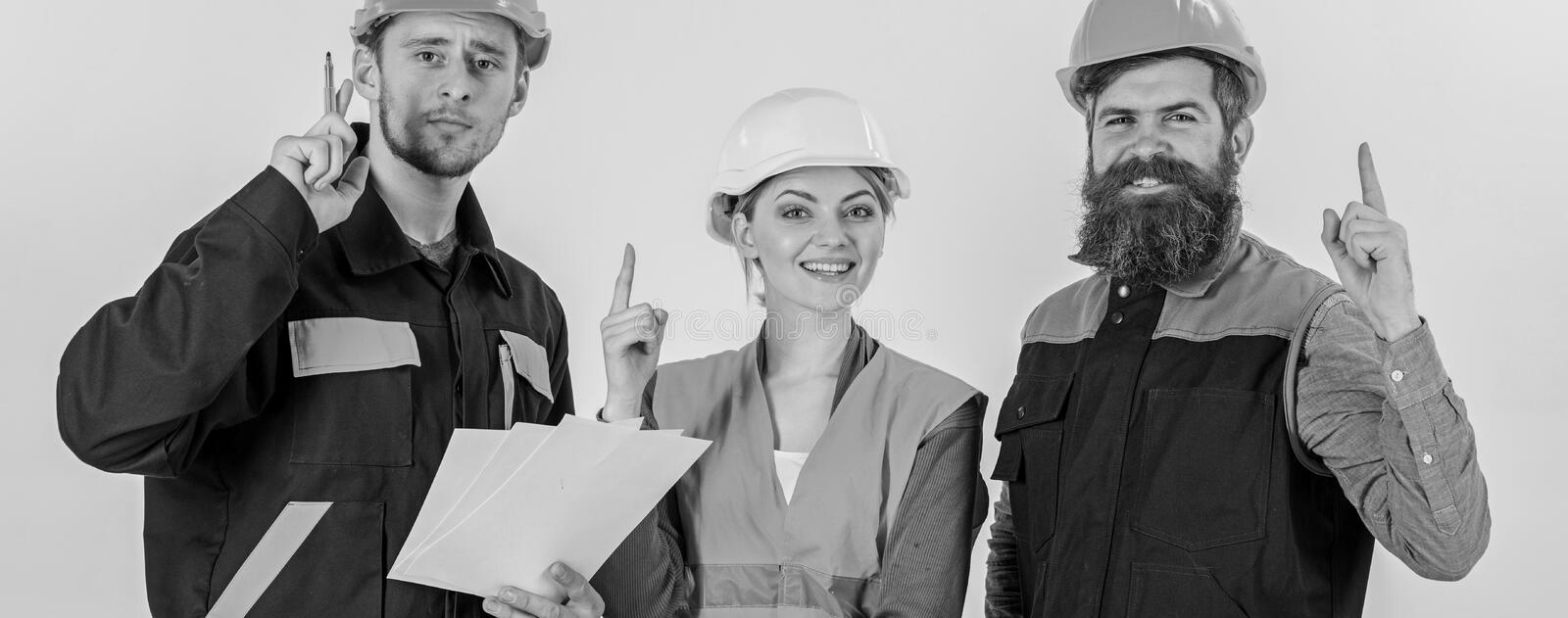 Three people have idea, success discussion, builders, stock images