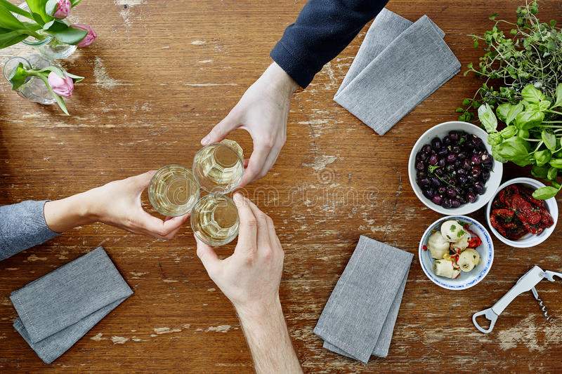 Three people toasting with wine royalty free stock photography