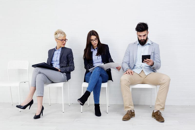 Group of people waiting and sitting stock photos