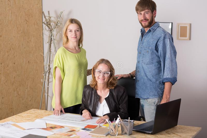Three people working together. Picture of three people working together for family company stock image