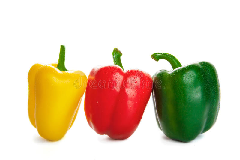 Three peppers in the droplets of water. on a white background.  royalty free stock photo