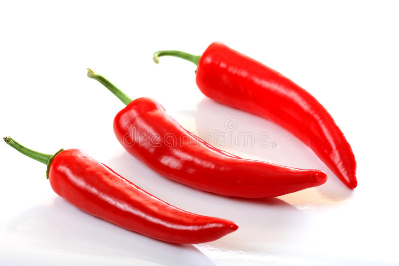 Three peppers on light background stock image