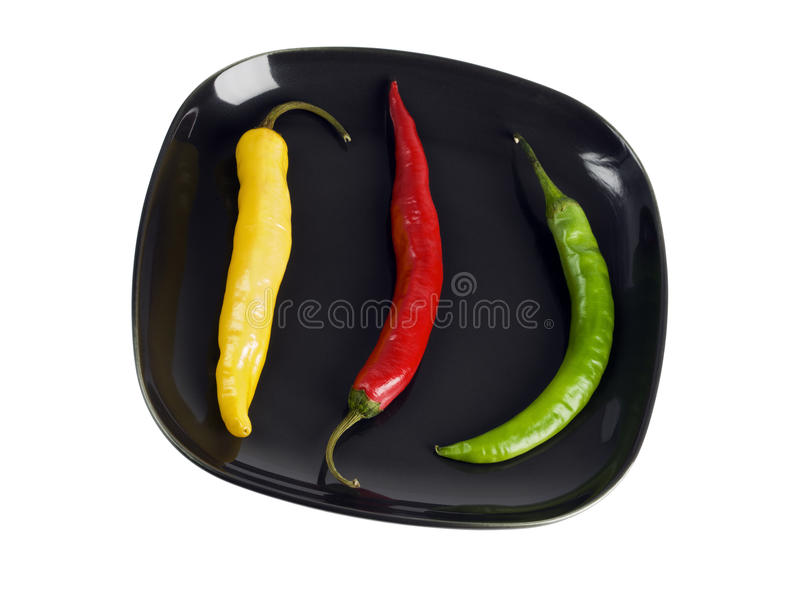 Three Peppers On A Plate Royalty Free Stock Photo