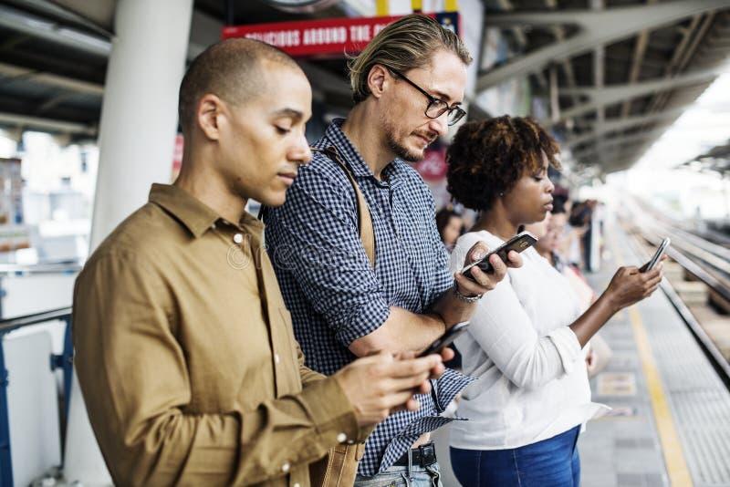 Three Person Holding Smartphones stock photos