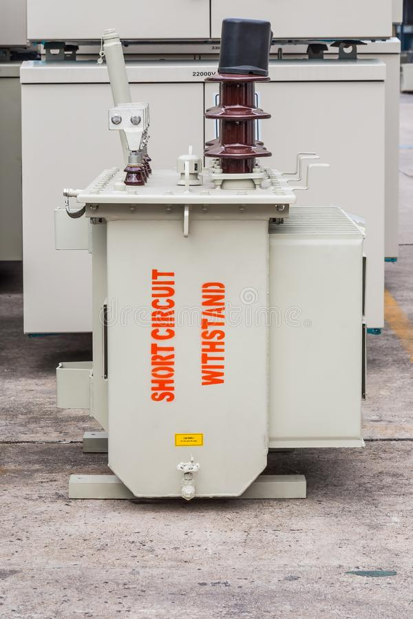 Three phase 100 kVA pole mounted transformer. Three phase 100 kVA pole mounted corrugated fin oil immersed transformer with `short circuit withstand` marking on royalty free stock photography