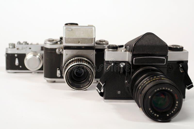 Three photo cameras royalty free stock photos