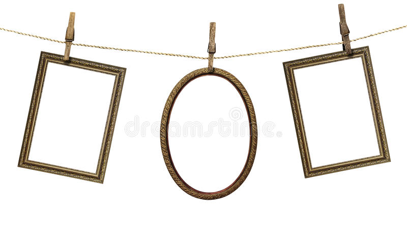 Three picture frame hanging on clothespins isolated on white bac royalty free stock photo