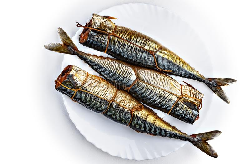 Three pieces of smoked scomber fish. stock image
