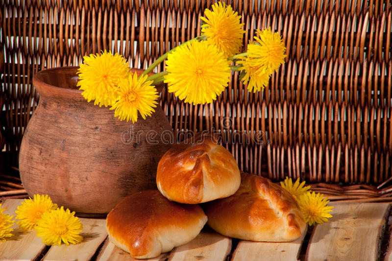 Download Three Pies And Dandelions In  Clay Pot Stock Photo - Image of summer, dough: 25121214