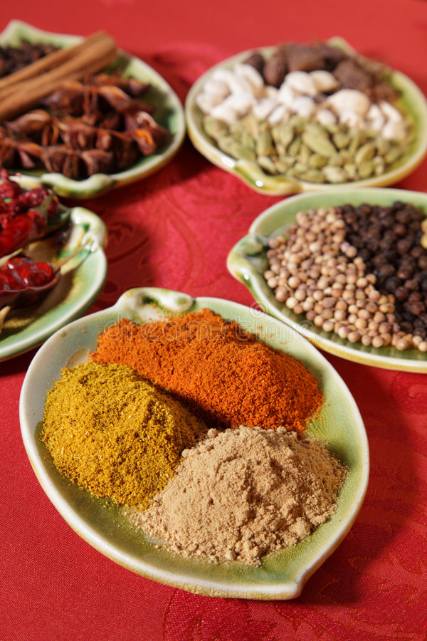 Three piles of indian powder spice on plate stock images