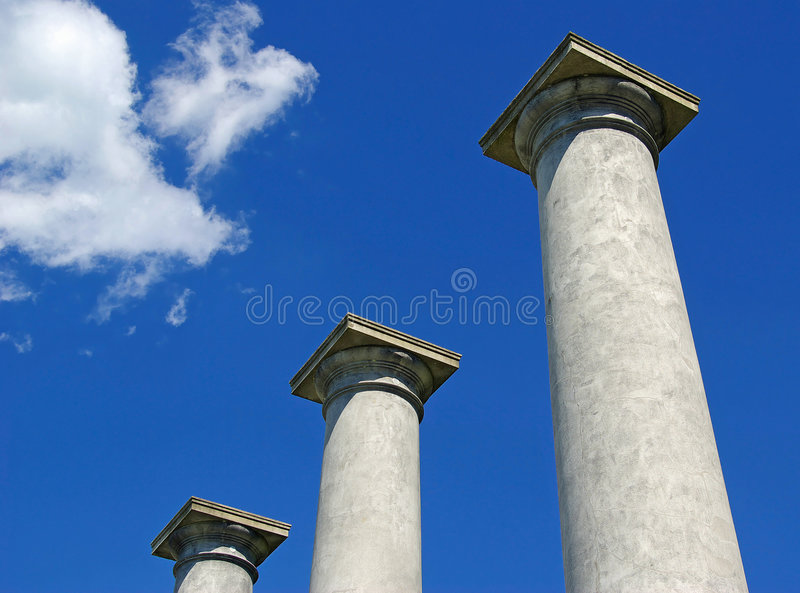 Three pillars. Three pillars from the ruins of an old mansion reach for the sky royalty free stock photography