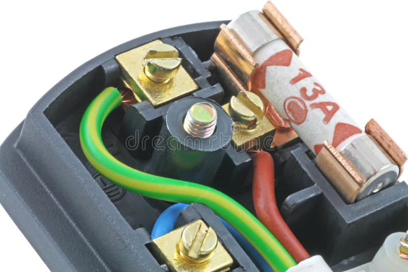 Three pin plug. An isolated UK plug on a white background with its cover removed showing the fuse and wiring royalty free stock photos
