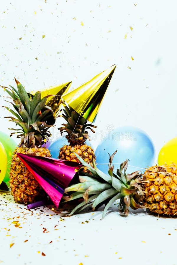 Three Pineapples With Gold Party Hats royalty free stock image